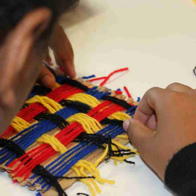 hand weaving textiles lesson